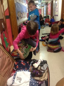 Sorting and packing warm clothing donations.